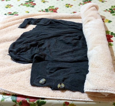 Roll garment in towel