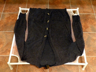 Clean sweater shaped and drying naturally on drying frame