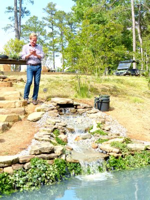 Allen applauds as water flows for the first time