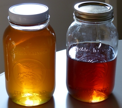 same beekeeper, just left jar is summer honey and right jar is spring honey.