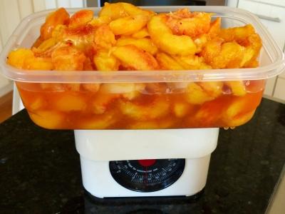Six pounds of prepared peaches ready for preserving