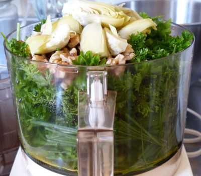 Rinse and spin equal amounts of curly parsley