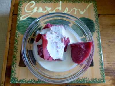 A bowl of concord grape sorbet floating in a pool of heavy cream. Grapes from my garden and oh so yummy! The tile is from a local estate sale.