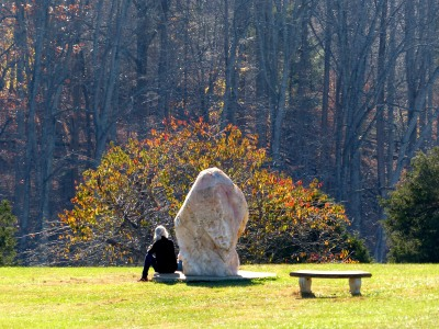 a guest spends time with a large rose quartz crystal at The Nancy Penn Center