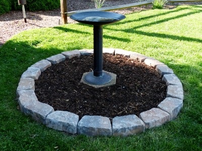 after a trip to town, twenty pavers completed the circle and mulch top dressed the project.