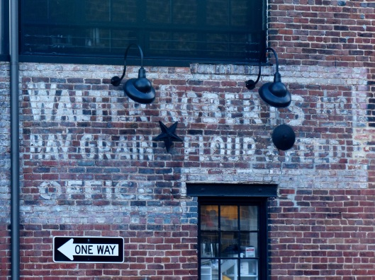 nearby, remnants of decades old signage on a waterfront warehouse