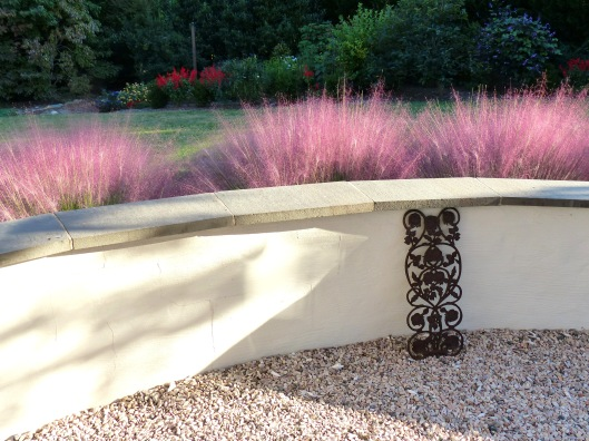 terrace wall refurbished with Muhly grass showing off on the other side...September is mighty showy here.