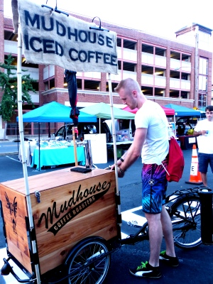 coffee makes the world go round, and this vendor peddles his way to market