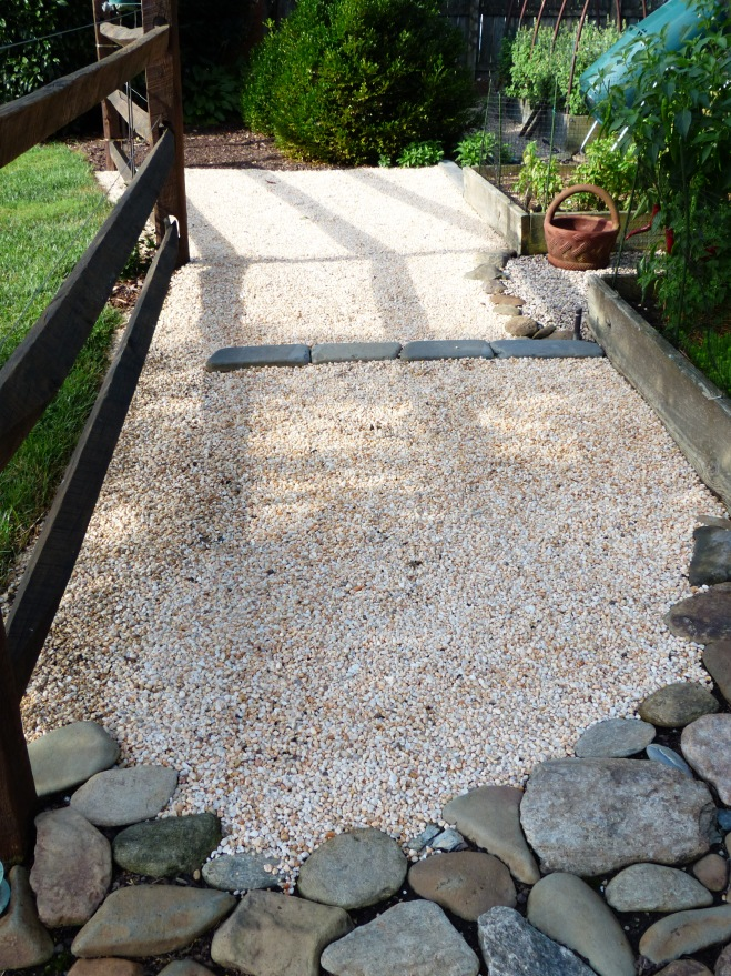 This was also a wash area every time it rained. So gravel was the answer. One heavy rain since placement confirms its success. Gravel will continue to replace mulch where ever it is appropriate. What took me so long???