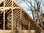 "I could not resist capturing how the sun played with this timber frame structure, a ""duplex"" that shares a central chimney."